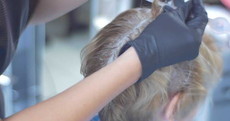 Stylist Hairdresser Makes Hair Coloring, Blonding. She Uses The ...
