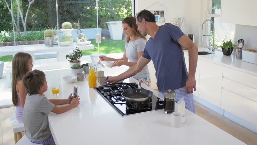 Happy Smiling Caucasian Family In The Kitchen Preparing Breakfast Together  And Having Fun Stock Footage Video 13159451 | Shutterstock