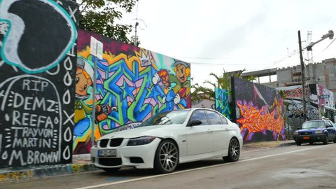 MIAMI - DECEMBER 2: Stock video of the Graffiti Walls and art at the streets of Wynwood which is a neighborhood north of Downtown Miami influenced by urban art and culture December 2, 2015 in Miami FL