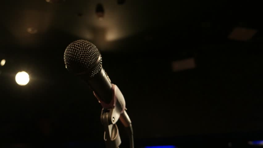 Image result for shutterstock pictures of an empty mic on a stage