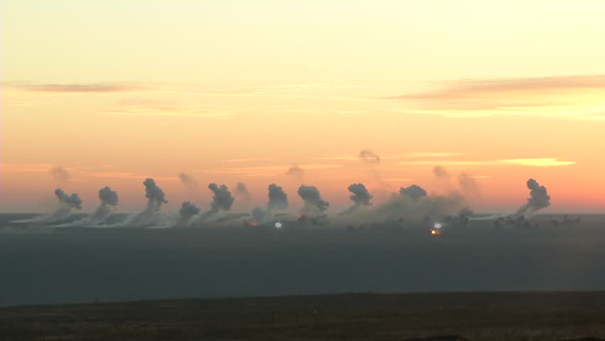 Battlefield in  fire: the bombardment of heavy artillery.Bombardment early in the morning. Many shells and thick smoke