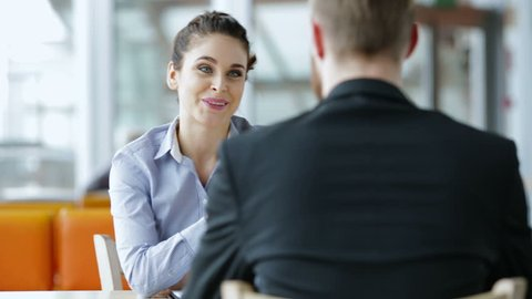 Job interview - happy recruiter shaking hand with candidate