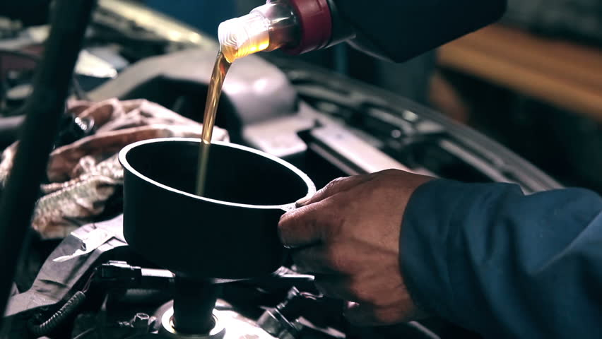 Process of changing engine oil in car service station