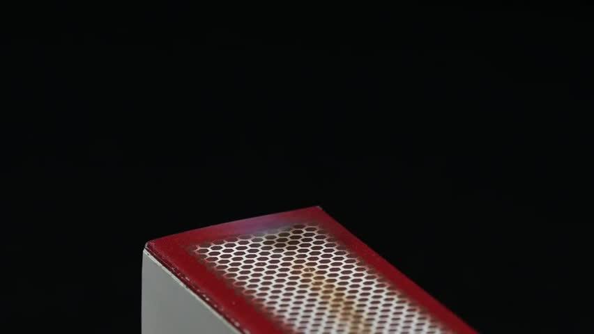 strike a match on a matches box