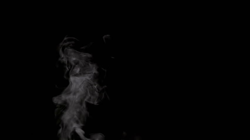 Slow Jet of Steam from a Cup. White smoke on black background. Motion at a rate of 240 fps