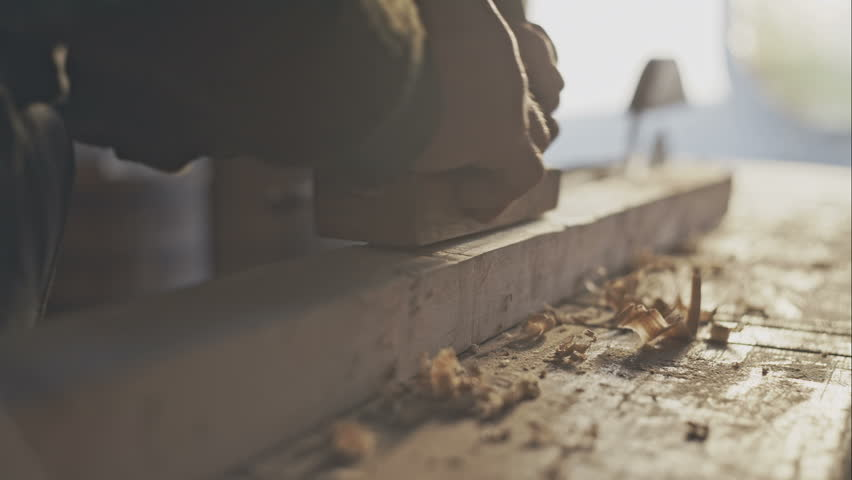 Hands of a carpenter planed wood, workplace | Shutterstock HD Video #13277801