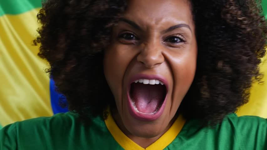 Afro-Brazilian celebrate with Brazil Flag on background