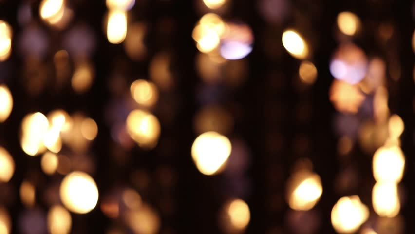 Abstract glittering lights, gold background, a real shot video in the blur | Shutterstock HD Video #13284878