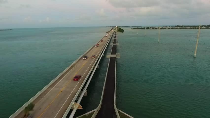 Aerial view of ocean and Seven Mile Bridge on Overseas Highway in Florida Keys at dusk