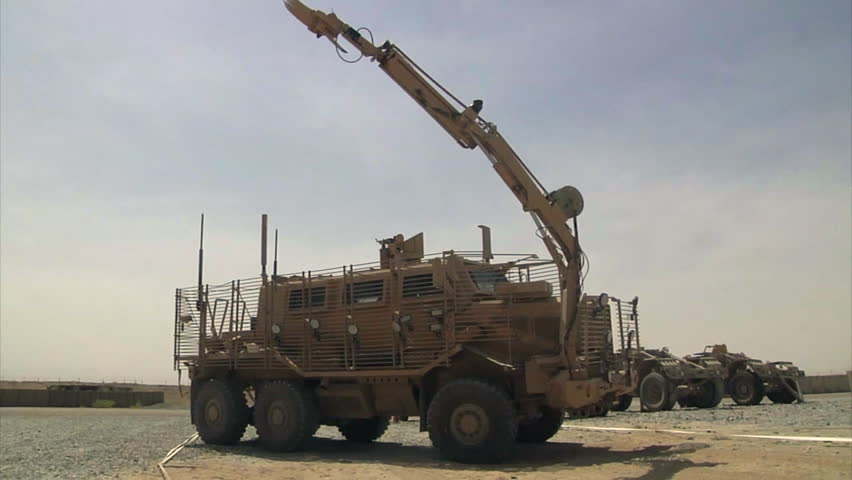 CIRCA 2010s - U.S. forces use special mine and IED clearing armored clearance vehicles in the war in Afghanistan.