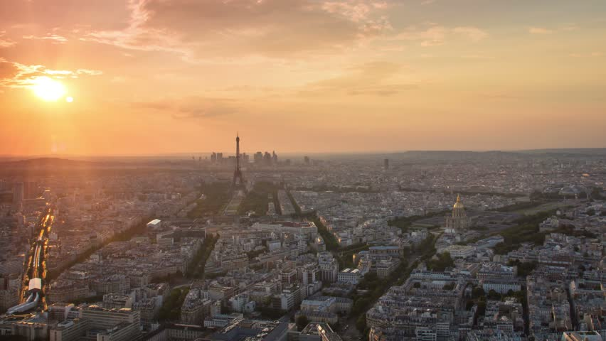 Paris city skyline cityscape aerial view time lapse from day to night pan panning starting at the sunset ending with city illuminated