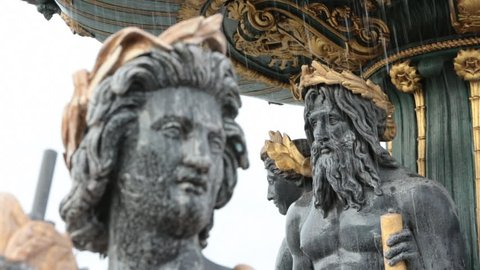 Focus pull on architectural detail of character on the 'Fontaines de la Concorde' at 'Place de la Concorde' in the center of Paris