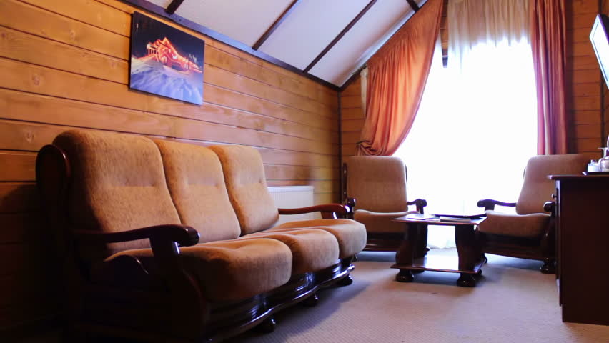 Suite room at the hotel. The room sofa, bed, table, chairs, TV, balcony. The house is made of wood. | Shutterstock HD Video #13396751