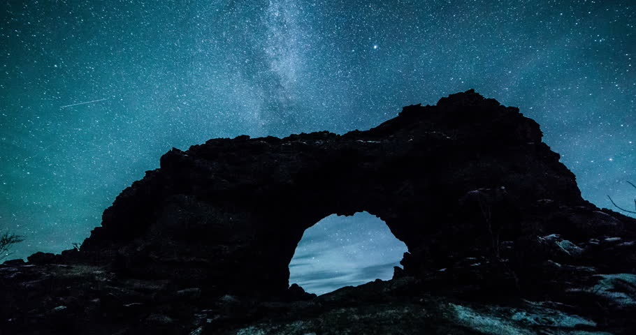 Aurora borealis and stars with volcanic rock formations at Dimmuborgir, Iceland
