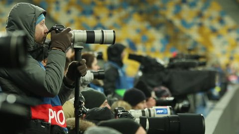 Kiev, Ukraine, 09 December 2015: Photographers shoot on the pitch during a match commands Dynamo Kiev and Maccabi Tel Aviv in the group stage of the Champions League. Case Number: 02484149