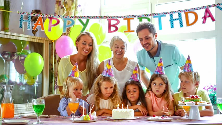 Family And Little Children At A Birthday Party