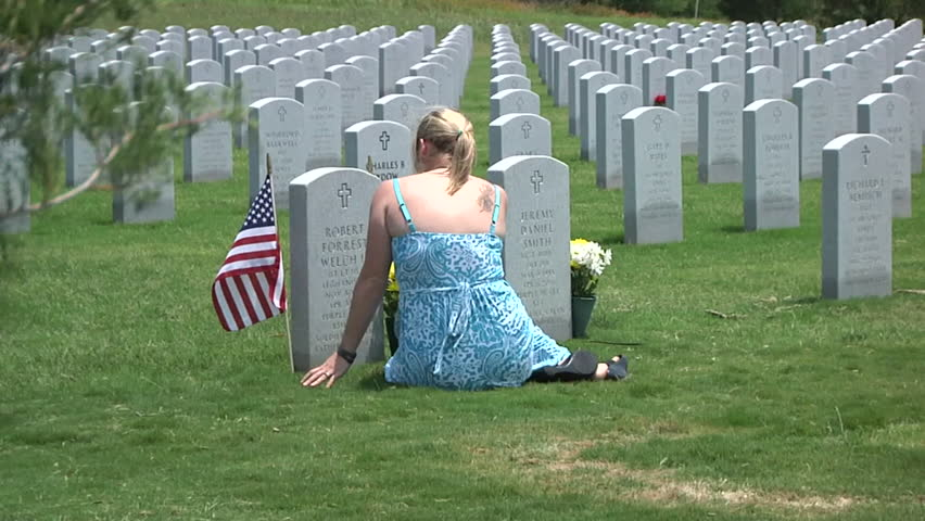 CIRCA 2010s - Soldiers honor the dead at a cemetery in Dallas Ft. Worth, Texas.