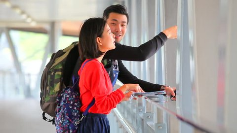 younger asian traveling man and woman standing with toothy smiling face use for modern people backpacker traveling lifestyle