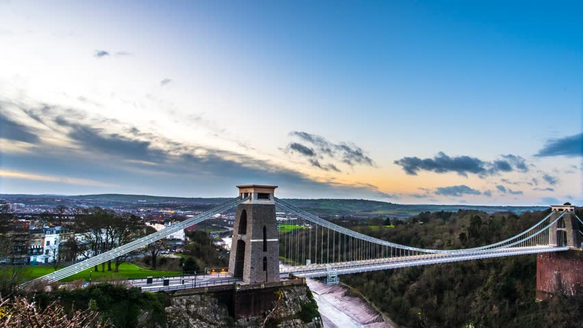 Sunrise at Clifton Suspension Bridge, Bristol with sunlight catching top of towers at the end