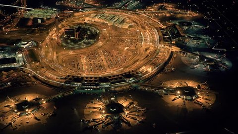 aerial view of an international airport terminal at night. illuminated airplane station background. airplane aviation business background