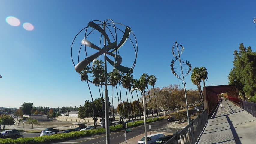 WHITTIER, CA/USA - December 14, 2015: Shot of wind sculptures on a bike path bridge. Whimsical pieces of art decorate the bicycle trail for cyclists crossing over bridge.