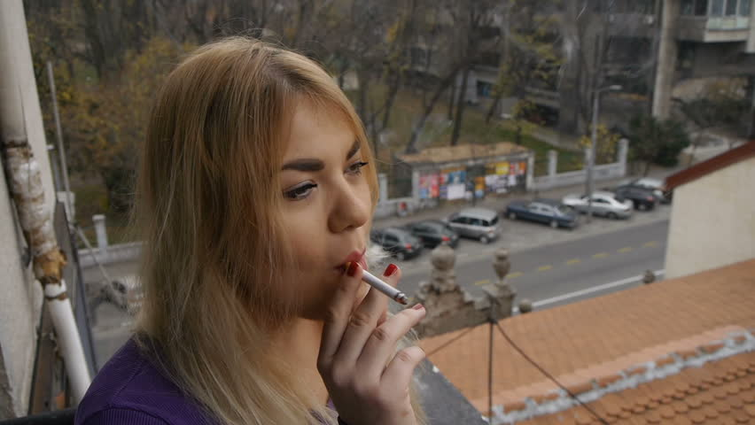 Pretty Blonde Girl Smoking A Stock Footage Video 100 -4189