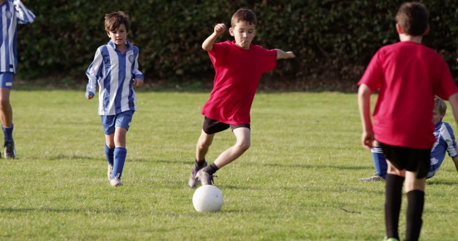 Children's soccer team on the field.   Shutterstock HD Video #13616033