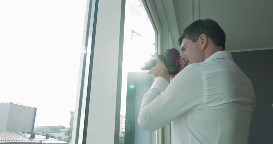 Photographer taking shots of city through the window | Shutterstock HD Video #13657571