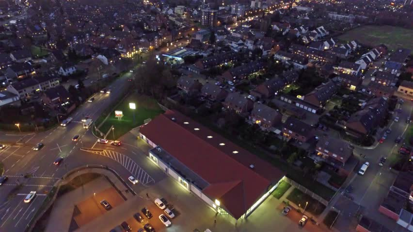 MOERS / GERMANY - JANUARY 03 2016 - Aerial shot of a Lidl supermarket in the evening