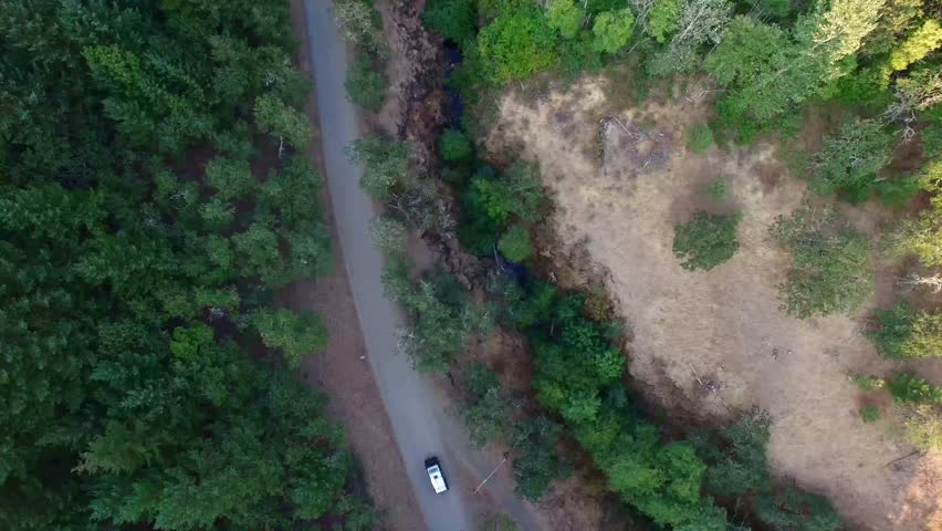 Classic VW Bus Drives Next Down To River - Aerial 4k - Drone