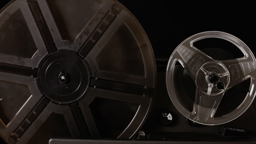 The running film rolls of a vintage Super 8mm projector in action. Detail shot. With diegetic audio.  | Shutterstock HD Video #13698791