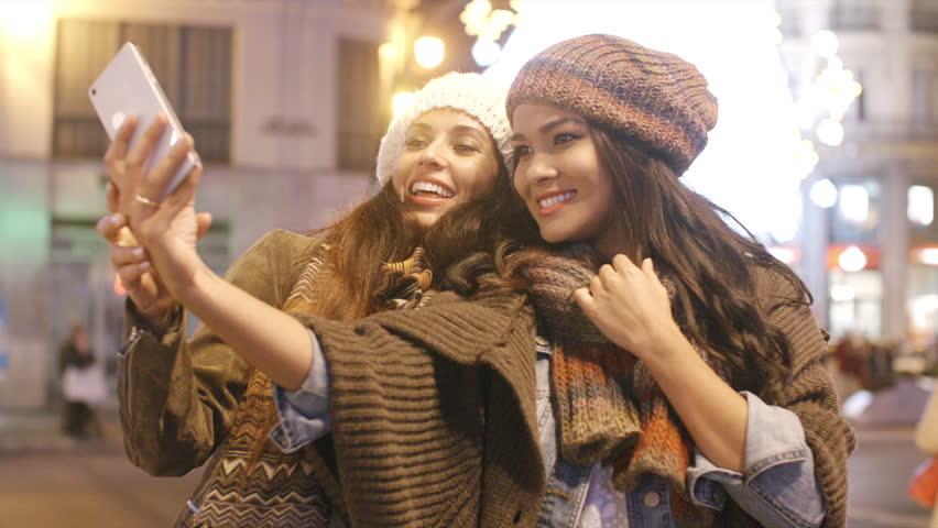 Two vivacious women taking a selfie