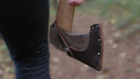 Closeup lumberjack holding axe