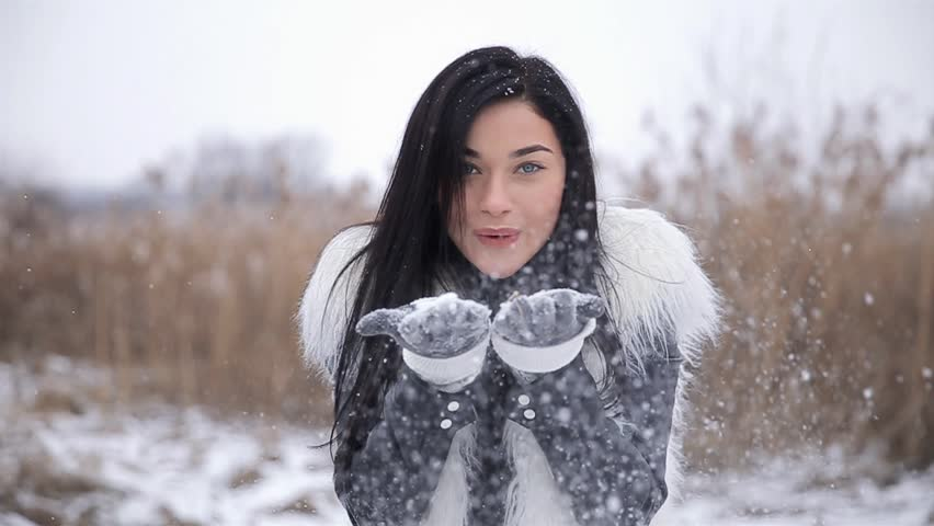 7097407c08ed2 Beautiful Young Smiling Winter Girl Blowing Snow On Field In Slow Motion