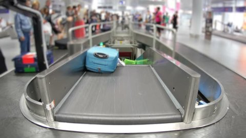 baggage claim area of terminal, inside airport