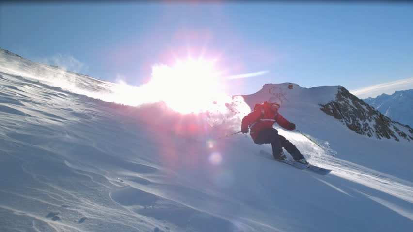 View of skier off run skiing with snowy mountains in sun ray and powdery snow / Stubai, Central Eastern Alps, Innsbruck, Austria - Stubai, Central Eastern Alps, Innsbruck, Austria, July, 2015 | Shutterstock HD Video #13846010