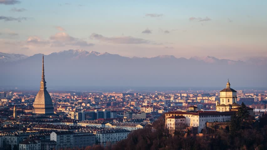 Turin (Torino) HD timelapse panorama with Mole Antonelliana, Monte dei Cappuccini and the Alps in the background. Shooted from sunset to twilight