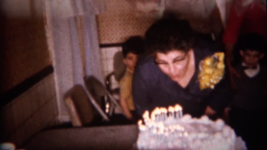 BUFFALO NEW YORK 1959 Lady Blows Out Birthday Cake With Many Smoking Candles