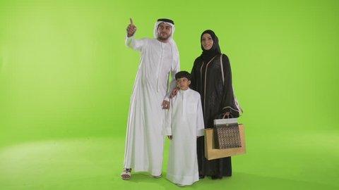 Arab family looking with curiosity. Dubai, UAE -- July 2015