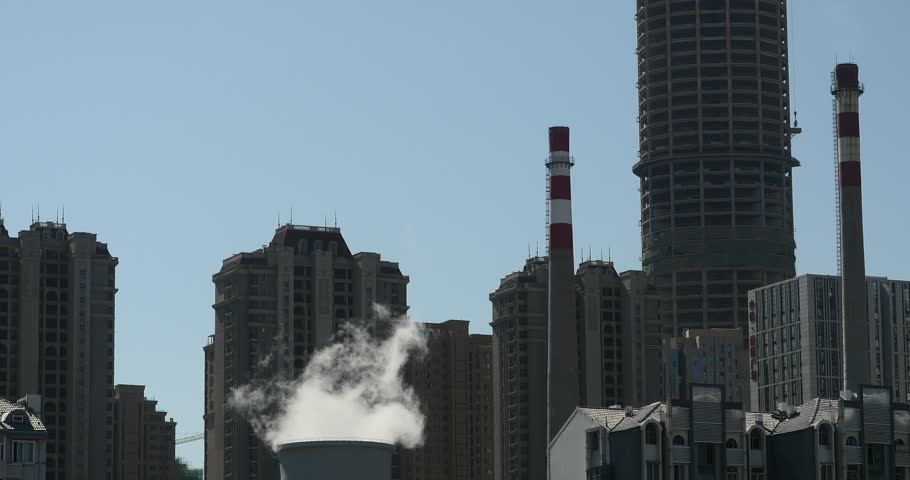 4k fumes billow from industry chimney,energy generation pipe with smoke,urban building background. gh2_11060_4k
