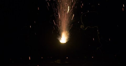 Small spark fountain fireworks.  120fps slow motion.