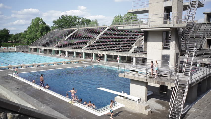 germany circa july 2015 kids jump off diving board at berlin olympic stadium pool