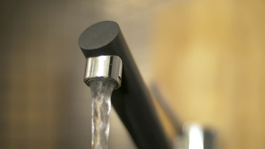 A Macro Of Dripping Kitchen Faucet Spout, Water Waste (4k Uhd ...