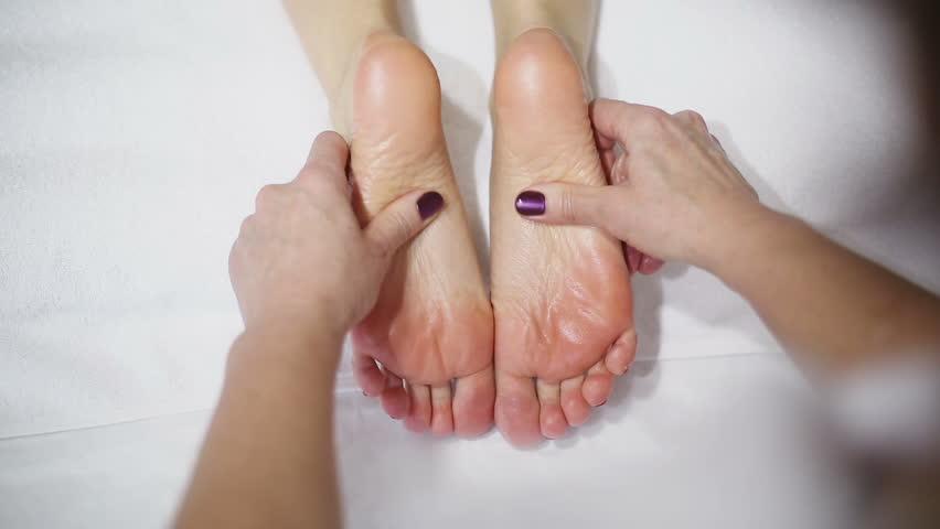 Female hands doing foot massage | Shutterstock HD Video #13928147