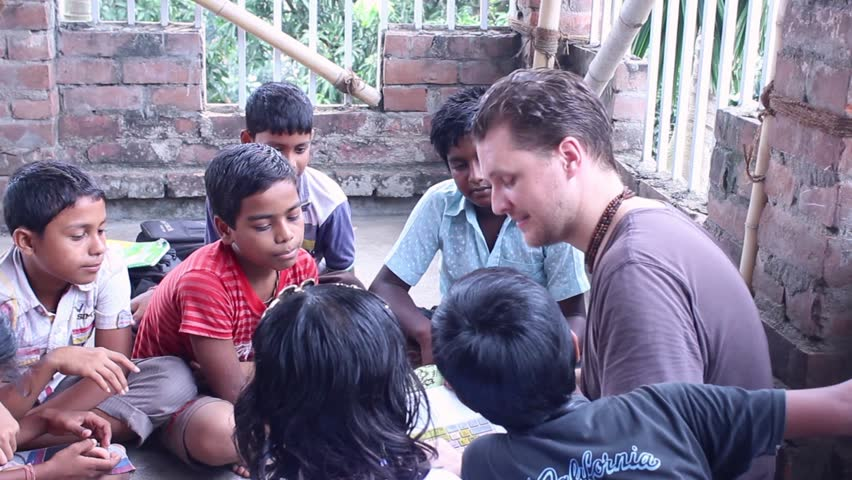 NABADWIP DHAM, INDIA, AUGUST 19th, 2015 -  Australian teacher at the Golden Avatar School has fun teaching kids English in Bengal, India