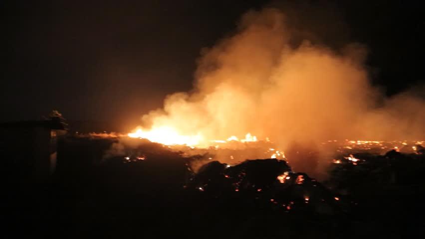 Fire in a field at night   Shutterstock HD Video #13949141