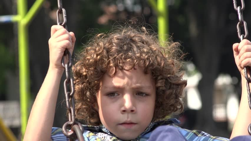 Boy Swinging on Swing Set | Shutterstock HD Video #13957031