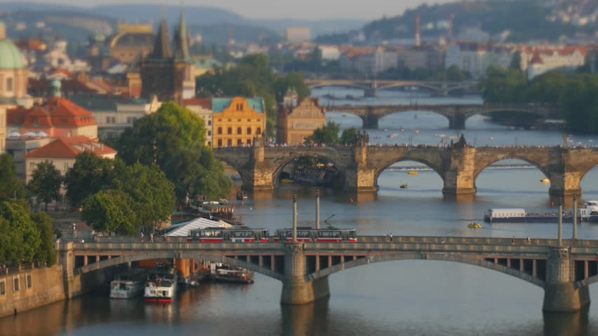 Beautiful evening view of Prague's center part with bridges above Vltava river through tilt & shift lens, Czech Republic