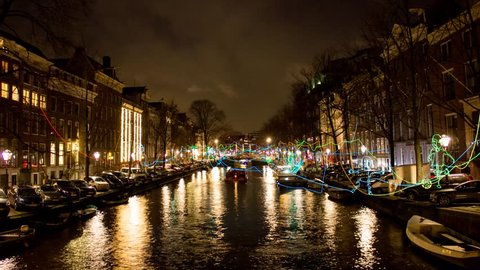 Timelapse of a canal in Amsterdam with light decorations.
