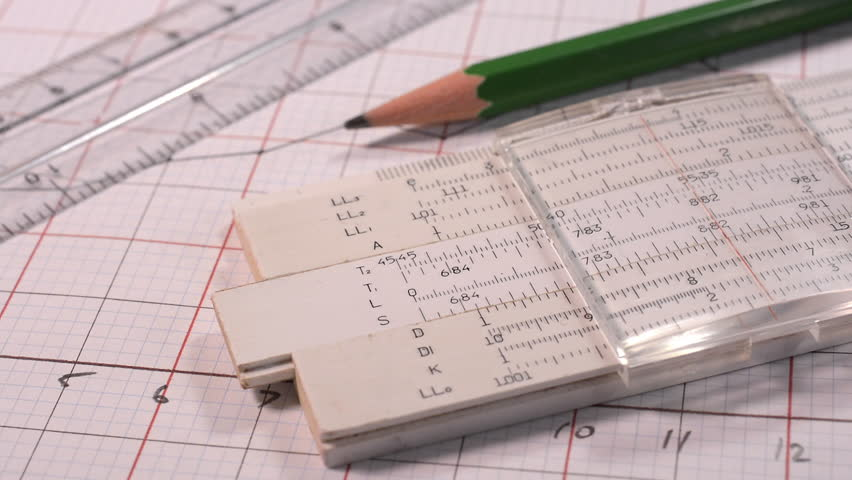 Using an old slide rule to make calculations in the construction of a graph. | Shutterstock HD Video #13965206